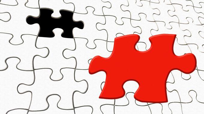 赤いピースと黒いピースが1個ずつまざった無地のパズル