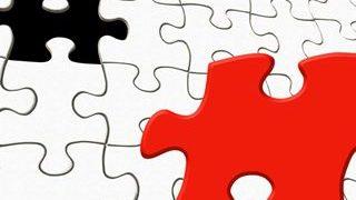 赤いピースと黒いピースが1個ずつまざった無地のパズルの小さい画像